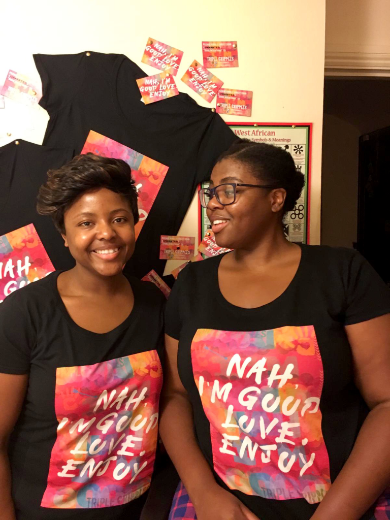 Jumoke & Kym side by side wearing their 'Nah, I'm good love, enjoy' t-shirts.